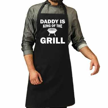 Daddy is king of the grill bbq / barbecue cadeau katoenen keukenschort zwart heren